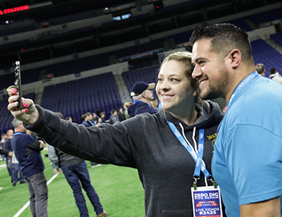 Couple smiling taking a selfie at the spartan tool wastewater industry kick off party at Lucas Oil Stadium