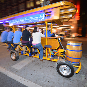 small group pedaling their way through the streets of Indy on a private open-air bike bar