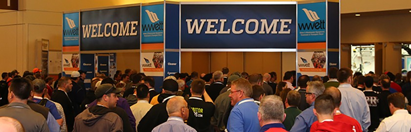 crowd gathering to enter the wwett show marketplace expo hall and a welcome banner clearly showing crowd where to enter